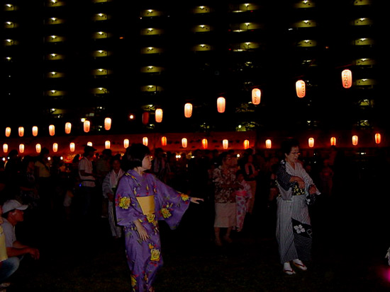 traditional japanese dancers in yukata at the summer festival in akishima, tokyo